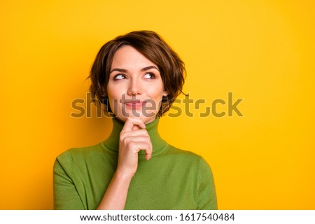 Closeup photo of amazing short hairdo lady looking up empty space deep thinking creative person arm on chin wear casual green turtleneck isolated yellow color background ストックフォト ©