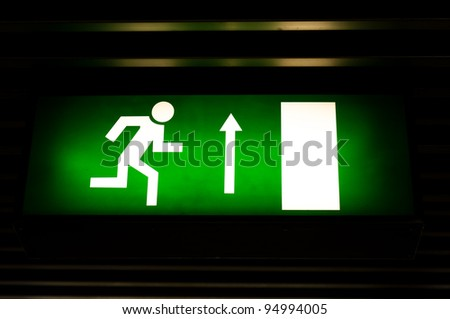 Closeup photo of an exit sign in the metro