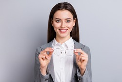 Closeup photo of attractive business lady perfect appearance beaming smiling taking off specs good eyesight after laser operation wear white shirt plaid blazer isolated grey color background