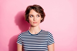 Closeup photo of attractive interested lady short hairdo clever eyes look side empty space wondered wear casual white blue t-shirt isolated pastel pink color background