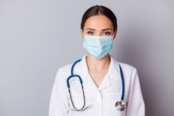 Closeup photo of attractive serious virologist doc lady experienced professional listen patient wear facial mask medical uniform lab coat stethoscope isolated grey background