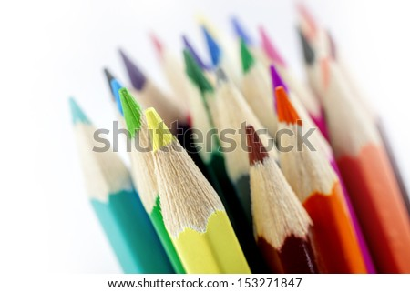 closeup photo of bunch of colored pencils on bright background /colored pencils