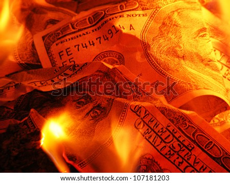 Closeup photo of burning dollars