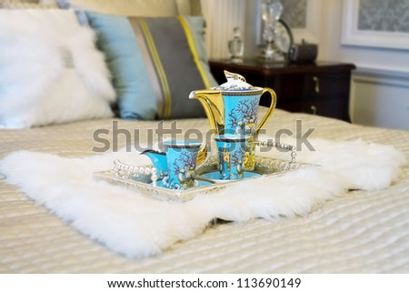 Closeup photo of Chinese beverage suite on wedding bed to celebrate the couple