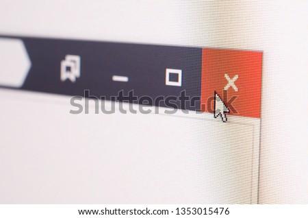 Closeup photo of cursor in internet browser click to closing cross. #1353015476