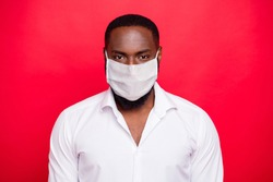 Closeup photo of dark skin macho guy stay safety home concept wear white formalwear shirt protective flu facial mask isolated bright red background