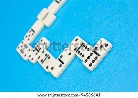 Closeup photo of domino bricks on blue background