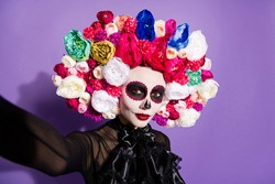 Closeup photo of funny folklore witch creature character death day facial creepy makeup masquerade mexican holiday make take selfies wear floral headwear costume isolated violet background