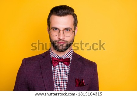 Closeup photo of handsome rich clothes stylish guy boyfriend business man party look well-dressed wear specs tie bow plaid shirt blazer isolated yellow vibrant vivid color background Foto stock ©