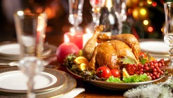 Closeup photo of hot freshly baked turkey on family festive dinner
