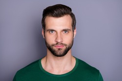Closeup photo of macho attractive guy perfect appearance neat groomed hairdo bristle not smiling clever eyes wear casual green t-shirt isolated grey color background