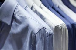 Closeup photo of Men's shirts hanging.