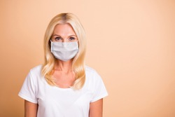 Closeup photo of middle age lady have breating mask good-looking stay home concept wear white casual t-shirt isolated pastel beige background