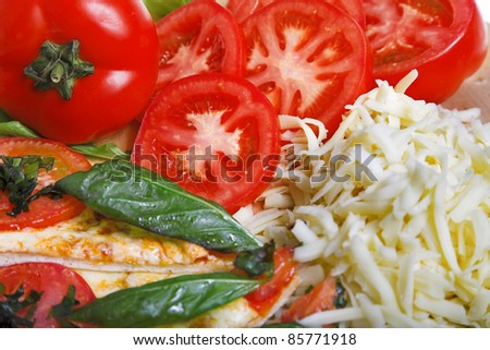 closeup photo of pizza margarita with ingredients