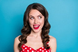 Closeup photo of pretty funny wavy lady licking plump tempting lips look side empty space dream of yummy tasty dinner wear red dotted dress singlet isolated blue color background