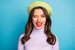 Closeup photo of pretty lady good mood red lips coquettish person blinking one eye see handsome guy wear green beret hat purple turtleneck isolated blue color background