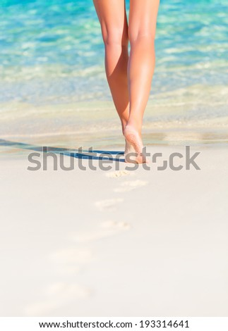 Closeup photo of sexy woman legs, body part, slim female walking on the beach, carefree lifestyle, summer vacation, relaxation concept #193314641