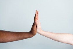 Closeup photo of two arms clap giving five different race multinational relationship antiracism issue help together world globe partners immigration integration isolated grey color background