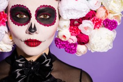 Closeup photo of voodoo alive awake dead witch religion folklore creature saint bride face print katrina scary makeup wear floral headwear band black dark costume isolated purple background