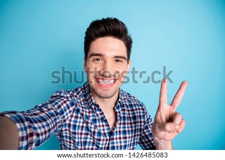 Closeup photo portrait of handsome positive cheerful he guy having free time video call making selfie give v-sign to viewers followers isolated pastel background