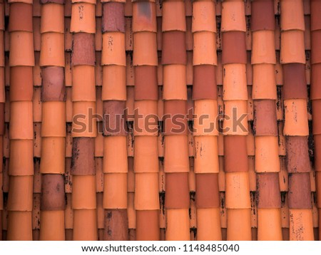Closeup photograph of a new red clay tile roof from above with rounded overlapping rows of tile on a home in Dubrovnik Croatia in Europe. #1148485040