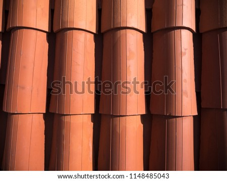 Closeup photograph of a new red clay tile roof from above with rounded overlapping rows of tile on a home in Dubrovnik Croatia in Europe. #1148485043