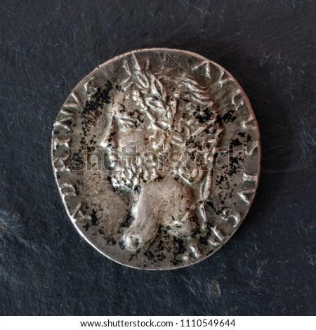 Closeup photograph of a silver denarius coin of the Roman Emperor Hadrian. Obverse view. #1110549644