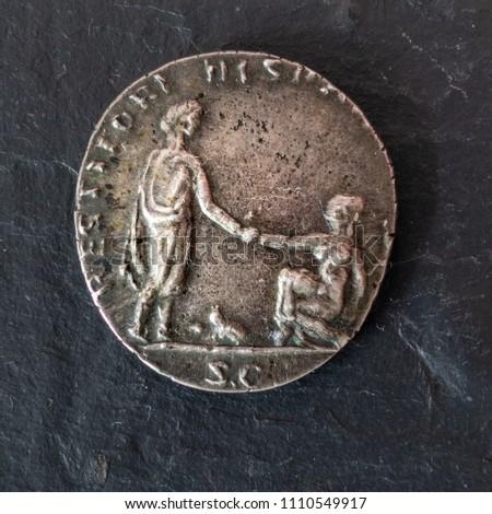 Closeup photograph of a silver denarius coin of the Roman Emperor Hadrian. Reverse Side. #1110549917