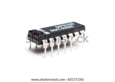 Closeup photograph of an single electronic integrated circuit chip on a white background