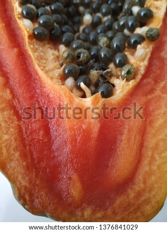 Closeup pic of PAPAYA and very good texture in red yellow and black color