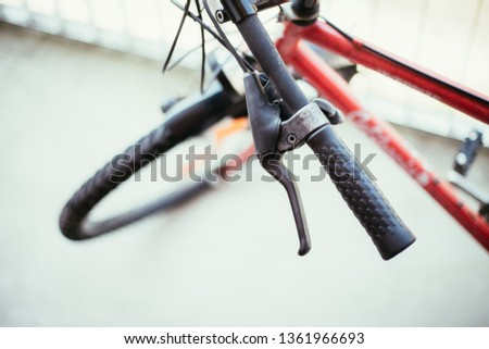 Closeup picture of a bicycle handlebar and breaks, bike repair, blurred background