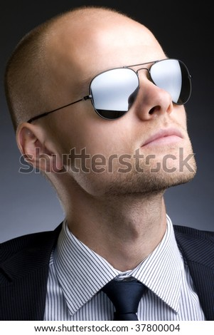 closeup picture of a businessman with sunglasses over black
