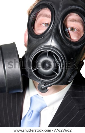 Closeup picture of a man with gasmask and suit on white - stock photo