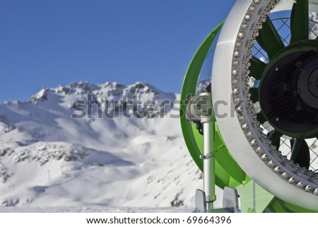 Closeup picture of an  idle snowcannon in the alps