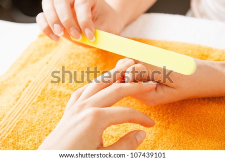 closeup picture of manicure process on female hands