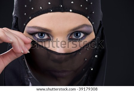 Stock Photo closeup picture of ninja face in the dark