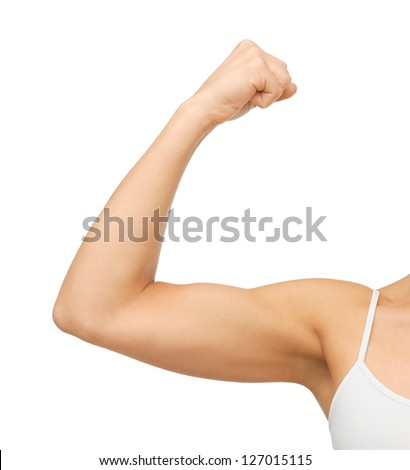 closeup picture of sporty woman flexing her biceps