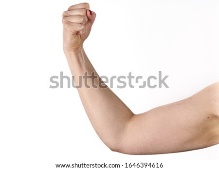 Photo of closeup picture of sporty woman flexing her biceps.
