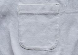 closeup pocket on white cotton shirt