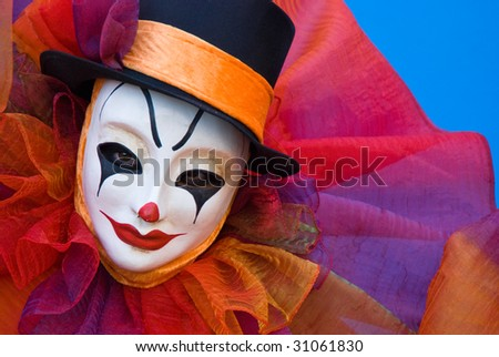 sad clown makeup. sad clown with white mask.