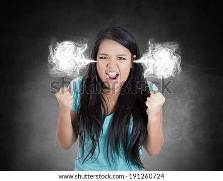 Closeup portrait angry, mad young woman, blowing steam coming out of ears about to have nervous atomic breakdown isolated black background. Negative human emotion, facial expression, feeling, attitude
