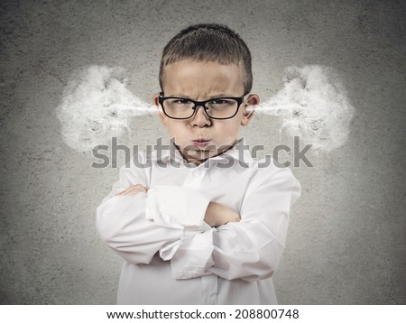 Closeup portrait Angry young Boy, Blowing Steam coming out of ears, about have Nervous atomic breakdown, isolated grey background. Negative human emotions, Facial Expression, feeling attitude reaction