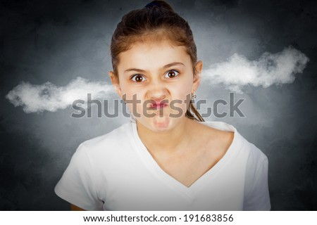 Closeup portrait angry young girl, blowing steam coming out of ears, about have nervous atomic breakdown, isolated black background. Negative human emotions facial expression feeling attitude reaction