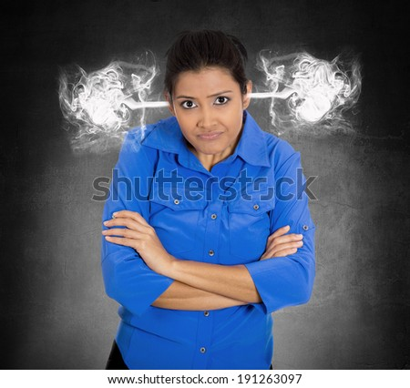 Closeup portrait angry young woman, blowing steam coming out of ears, about to have nervous atomic breakdown, isolated black background. Negative human emotions, facial expressions, feelings, attitude