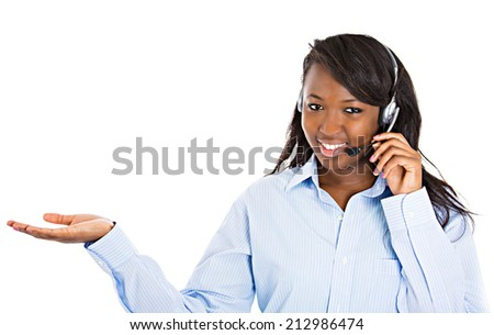Closeup portrait beautiful smiling female customer representative with phone headset pointing at copy space with hand isolated white background. Positive human emotions, facial expressions, attitude #212986474