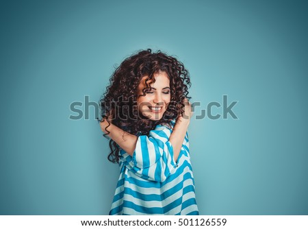 Photo of Closeup portrait confident smiling woman holding hugging herself isolated blue wall background. Positive human emotion, facial expression, feeling, reaction, situation, attitude. Love yourself concept