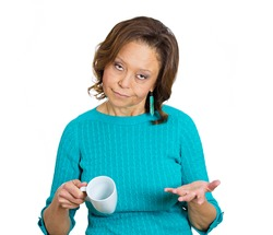 Closeup portrait, headshot grumpy, unhappy, annoyed boss, tired, sleepy old woman, asking where is my coffee, holding empty cup, isolated white background. Human face expressions, feelings, attitude