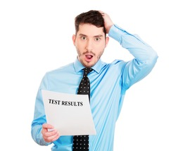 Closeup portrait, horrified, shocked, funny looking young man disgusted by his test results statement, isolated white background. Negative human emotion facial expression feelings.