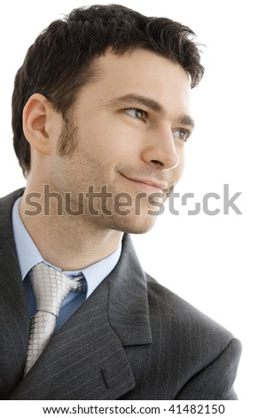 Closeup portrait if smiling businessman wearing grey suit and tie. Looking away, smiling. Isolated on white background.