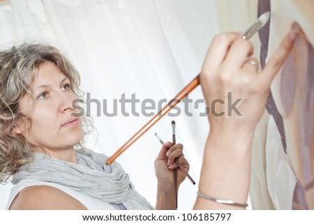 Closeup portrait of a beautiful artist, painter.